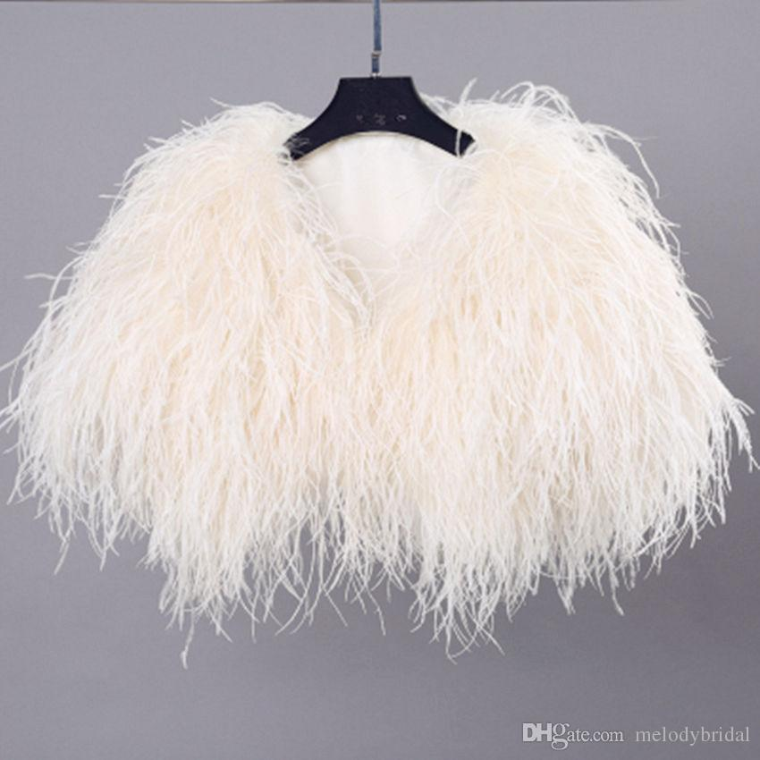 Fly like a bird: The feather bolero is winter's hottest new trend
